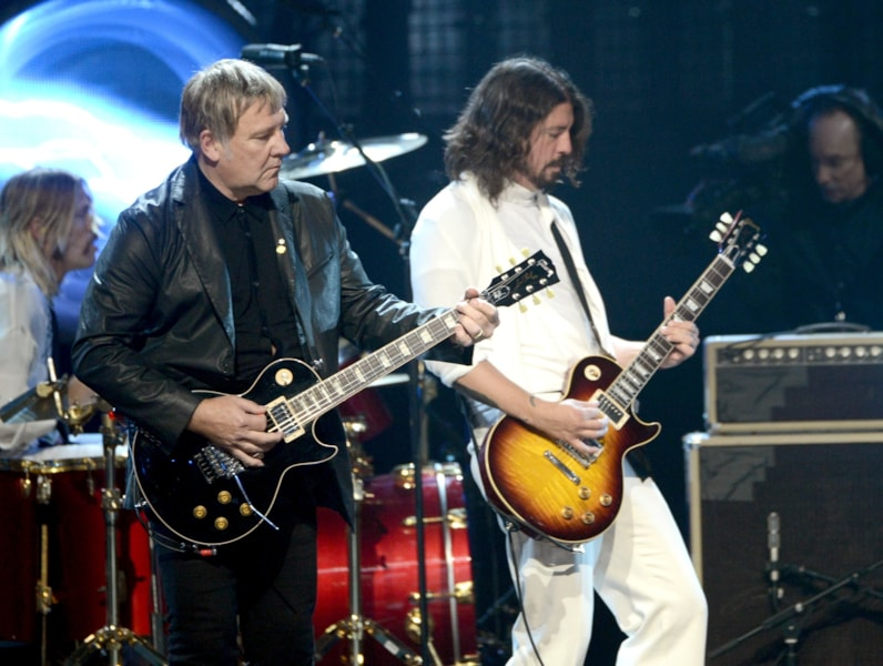 LOS ANGELES, CA - APRIL 18: Inductee Alex Lifeson of Rush (L) and musician Dave Grohl perform on stage at the 28th Annual Rock and Roll Hall of Fame Induction Ceremony at Nokia Theatre L.A. Live on April 18, 2013 in Los Angeles, California.  (Photo by Kevin Winter/Getty Images)