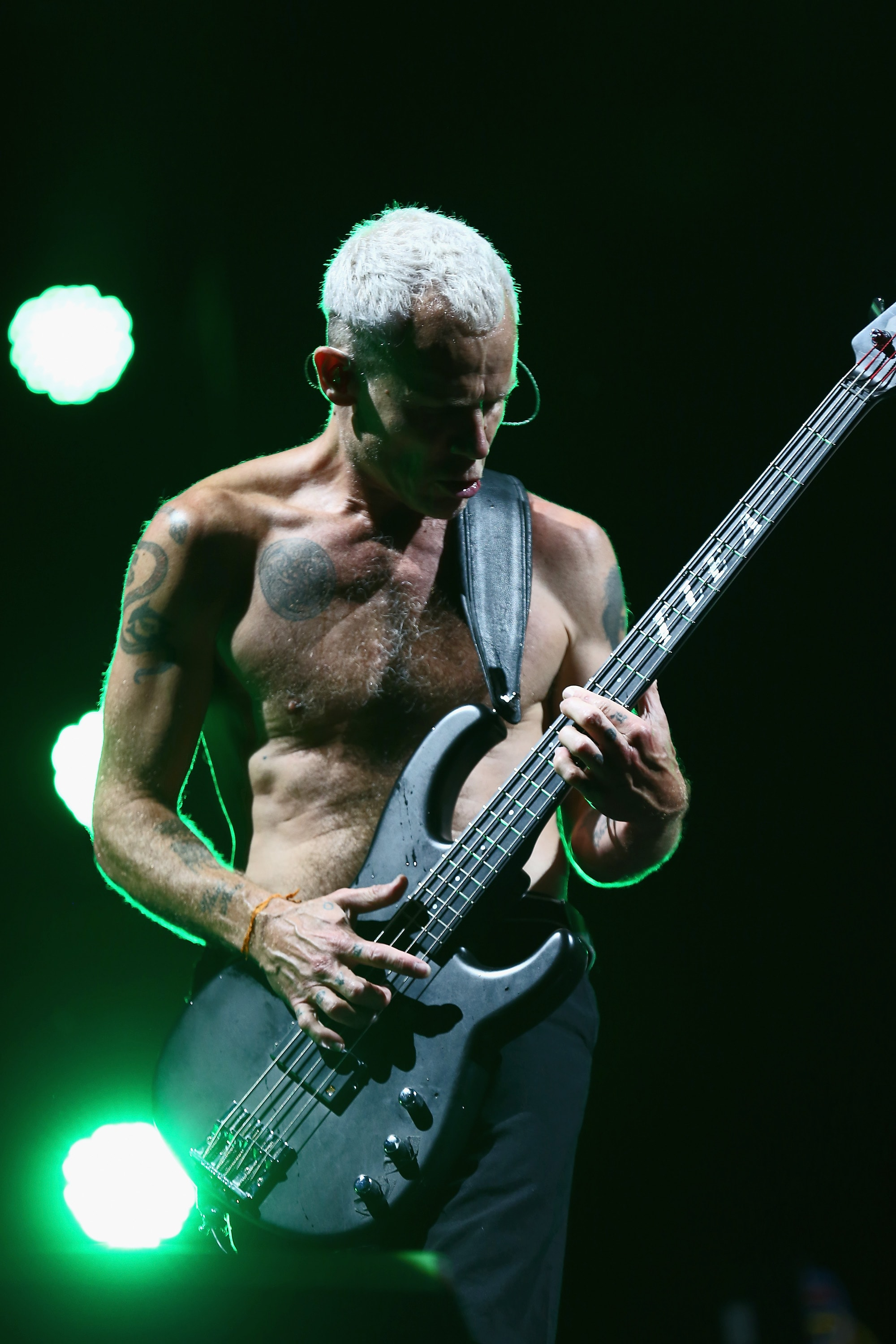 NEWPORT, ISLE OF WIGHT - JUNE 14: Red Hot Chili Peppers performs at The Isle of Wight Festival at Seaclose Park on June 14, 2014 in Newport, Isle of Wight.