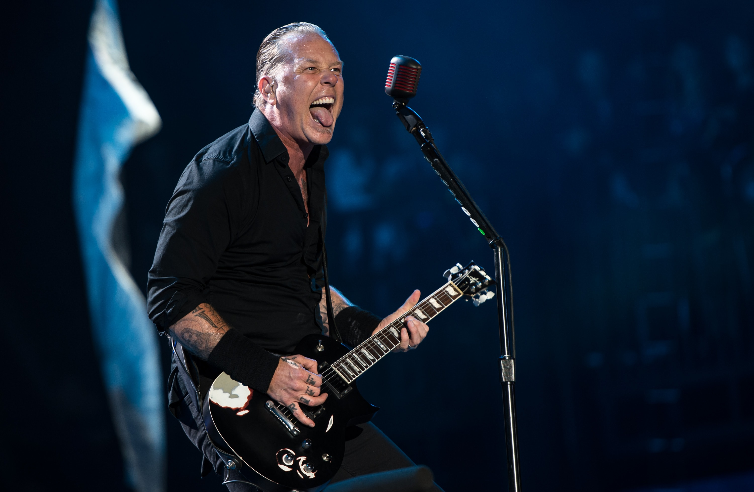 GLASTONBURY, ENGLAND - JUNE 28: James Hetfield of Metallica performs on the Pyramid stage during Day 2 of the Glastonbury Festival at Worthy Farm on June 28, 2014 in Glastonbury, England.