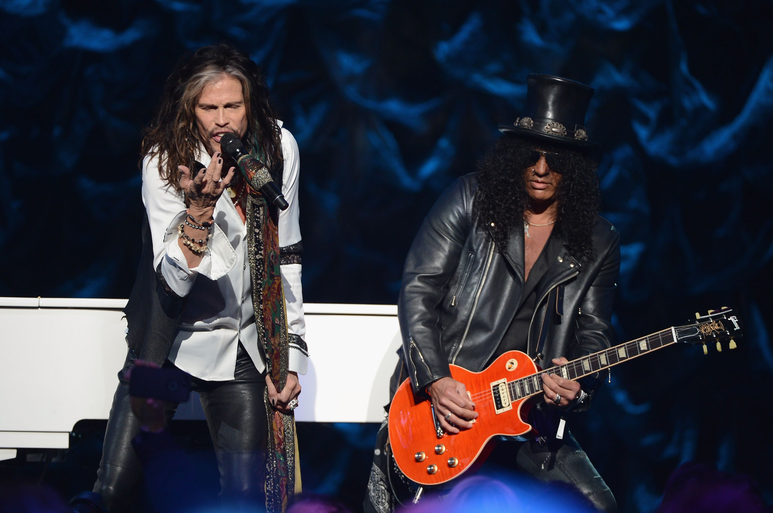 NEW YORK, NY - JANUARY 31: Steven Tyler and Slash perform onstage at 'Howard Stern's Birthday Bash' presented by SiriusXM, produced by Howard Stern Productions at Hammerstein Ballroom on January 31, 2014 in New York City.