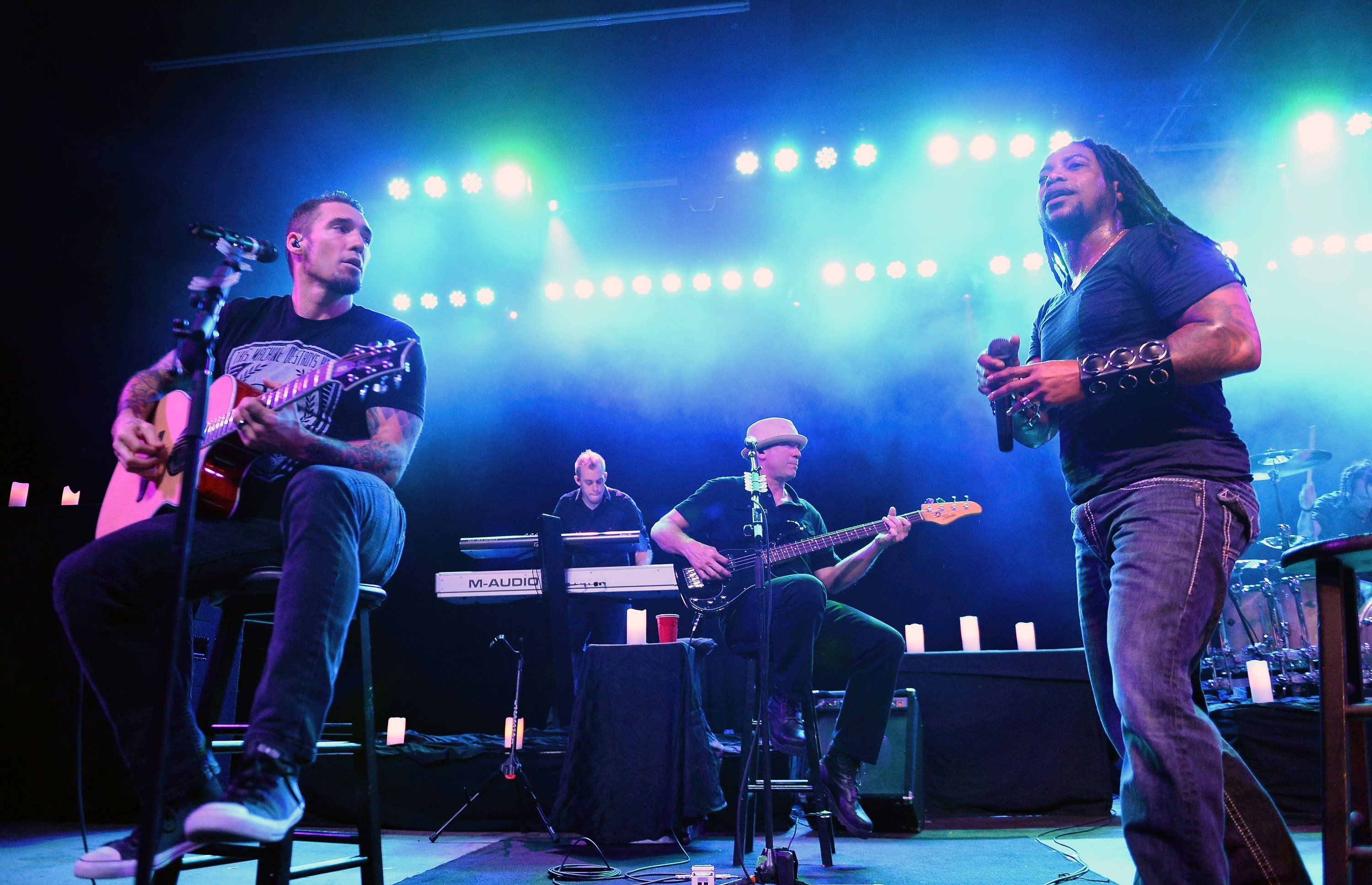 TEMPE, AZ - APRIL 08: (L-R) Guitarist Clint Lowery, touring keyboardist Kurt Wubbenhorst, bassist Vince Hornsby and singer Lajon Witherspoon of Sevendust perform during an acoustic concert at the Marquee Theatre as the band tours in support the upcoming album 'Time Travelers & Bonfires' on April 8, 2014 in Tempe, Arizona.
